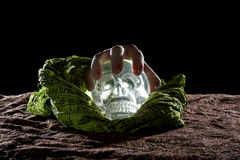 Hand on a Crystal Skull stock photos