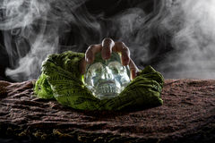 Hand on a Crystal Skull Stock Photo