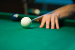 Hand with cue and ball Royalty Free Stock Images