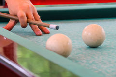 Hand with cue before the a blow to the billiard ball. Man hand with cue before the a blow to the billiard ball Royalty Free Stock Images