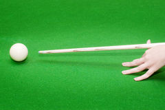 Hand with cue ready to hit Stock Photo