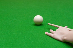 Hand with cue ready to hit a ball Royalty Free Stock Image