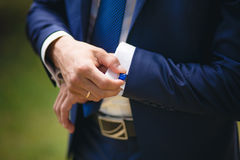 Hand with cufflink Royalty Free Stock Images