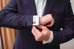 Hand with cufflink Stock Photography