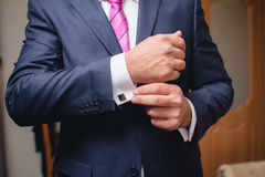 Hand with cufflink Royalty Free Stock Photo