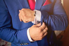 Hand with cufflink Stock Image