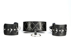 Hand cuffs and  collar a made of black leather. Fetish Hand cuffs and  collar a made of black leather Stock Photos