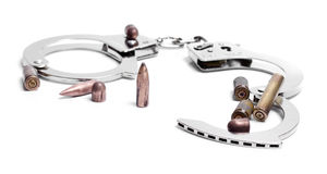 Hand cuffs and used bullets Royalty Free Stock Images