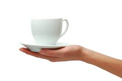 Hand with cup of coffee. Hand with white cup of coffee Stock Photos