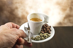 Hand with cup of coffee Stock Photography
