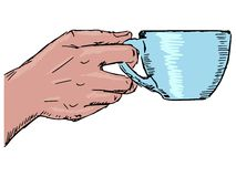 Hand with cup of coffee Stock Image