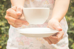 Hand on cup of coffee with vintage filter Royalty Free Stock Photo