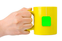 Hand with cup of tea royalty free stock photo