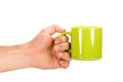 Hand and cup of tea Stock Image