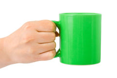 Hand with cup of tea Stock Photos