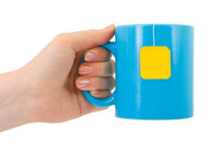 Hand and cup of tea Royalty Free Stock Image