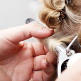 Hand curling hair stock image