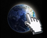 Hand cursor on Earth Stock Images