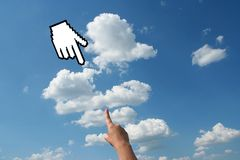 Hand with cursor on the sky. Hand with cursor on the blue sky Royalty Free Stock Images