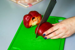 Hand cut the bell pepper on board Stock Photography