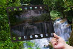 Hand cut film on Waterfal Royalty Free Stock Photo