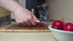 Hand cut radish on cutting board kitchen. Vegetable nutrition. stock video