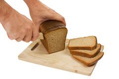 Hand cut rye bread on a board Stock Photo