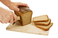 Hand cut rye bread on a board Royalty Free Stock Photo