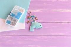 Hand cute felt dolphin keychain. Handbag charms. Handmade car keyring. Summer crafts for kids concept Royalty Free Stock Photos