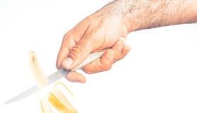Free Hand Cutting A Banana Royalty Free Stock Photo - 217820995