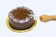 Hand cutting a birthday cake Stock Image