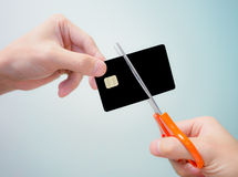 Hand cutting black chip card Stock Images