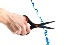 Hand cutting a blue ribbon with scissors isolated Royalty Free Stock Image