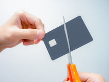 Hand cutting chip card Stock Photo