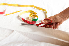Hand Cutting Cloth with Scissors Royalty Free Stock Images