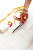 Hand Cutting Cloth with Scissors Royalty Free Stock Photography