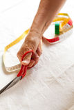 Hand Cutting Cloth with Scissors Stock Photos