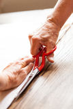 Hand Cutting Cloth with Scissors Royalty Free Stock Photo