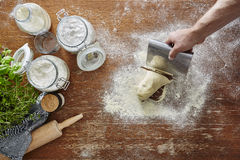 Hand cutting dough atmospheric kitchen. 