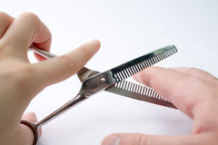 Hand cutting fingers with a scissors Royalty Free Stock Images