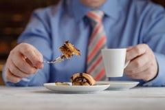 Hand cutting homemade caramel custard cake on white plate. On wo Royalty Free Stock Photography