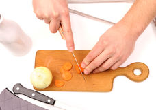Hand cutting onions Stock Images