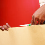 Hand cutting a paper Stock Image