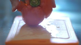 Hand cutting pepper in a kitchen stock video footage