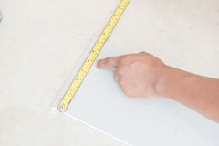 Hand cutting plaster boards Royalty Free Stock Photo