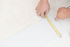 Hand cutting plaster boards Royalty Free Stock Images