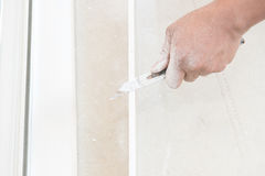 Hand cutting plaster boards Stock Images
