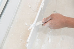 Hand cutting plaster boards Royalty Free Stock Photography