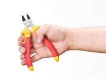 Hand with cutting pliers Stock Image