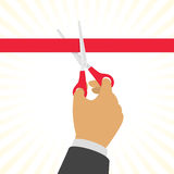 Hand cutting a red ribbon. Stock Image